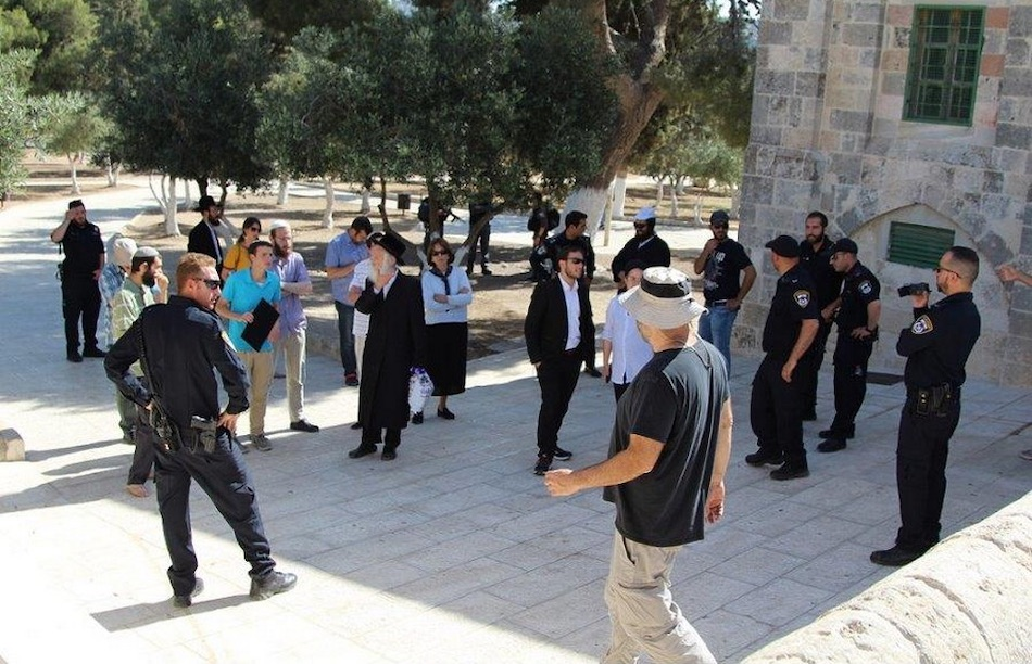 Groups of Jewish Extremists (some of them wearing their religious clothing) are allowed to enter Al-Aqsa Mosque / Al-Haram Al-Sharif under the protection of armed Israeli police officers