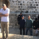 Barefooted Jewish extremists are allowed to pray in Al-Aqsa Mosque / Al-Haram Al-Sharif under the protection of armed Israeli police officers