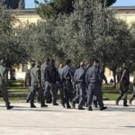 Armed Israeli Officers prepare themselves to pass by the Qibli Mosque