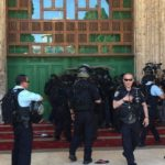 Large numbers of heavily armed Israeli police officers forcibly storm into Al-Jame' Al-Aqsa